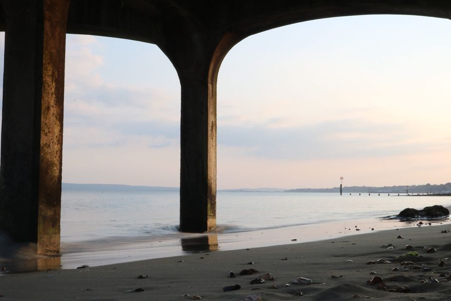 Water Sky Sea Land Beach Horizon Over Water Scenics - Nature Horizon Beauty In Nature Tranquility Nature Cloud - Sky Tranquil Scene No People Sunset Architecture Day Idyllic Sand Architectural Column