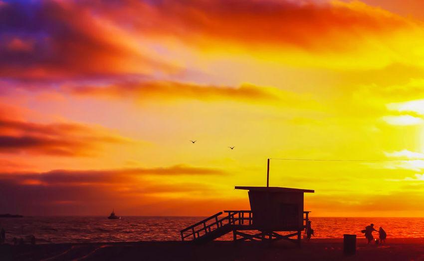 End of the day... Sunset at Grand Beach, El Segundo, CA Beach, Sunset, Lifeguard, Orange, Sky, Birds, Clouds, Color, Nature, California Coastline Silhouette El Segundo Ocean Silhouette Tranquil Scene Travel\ Yellow