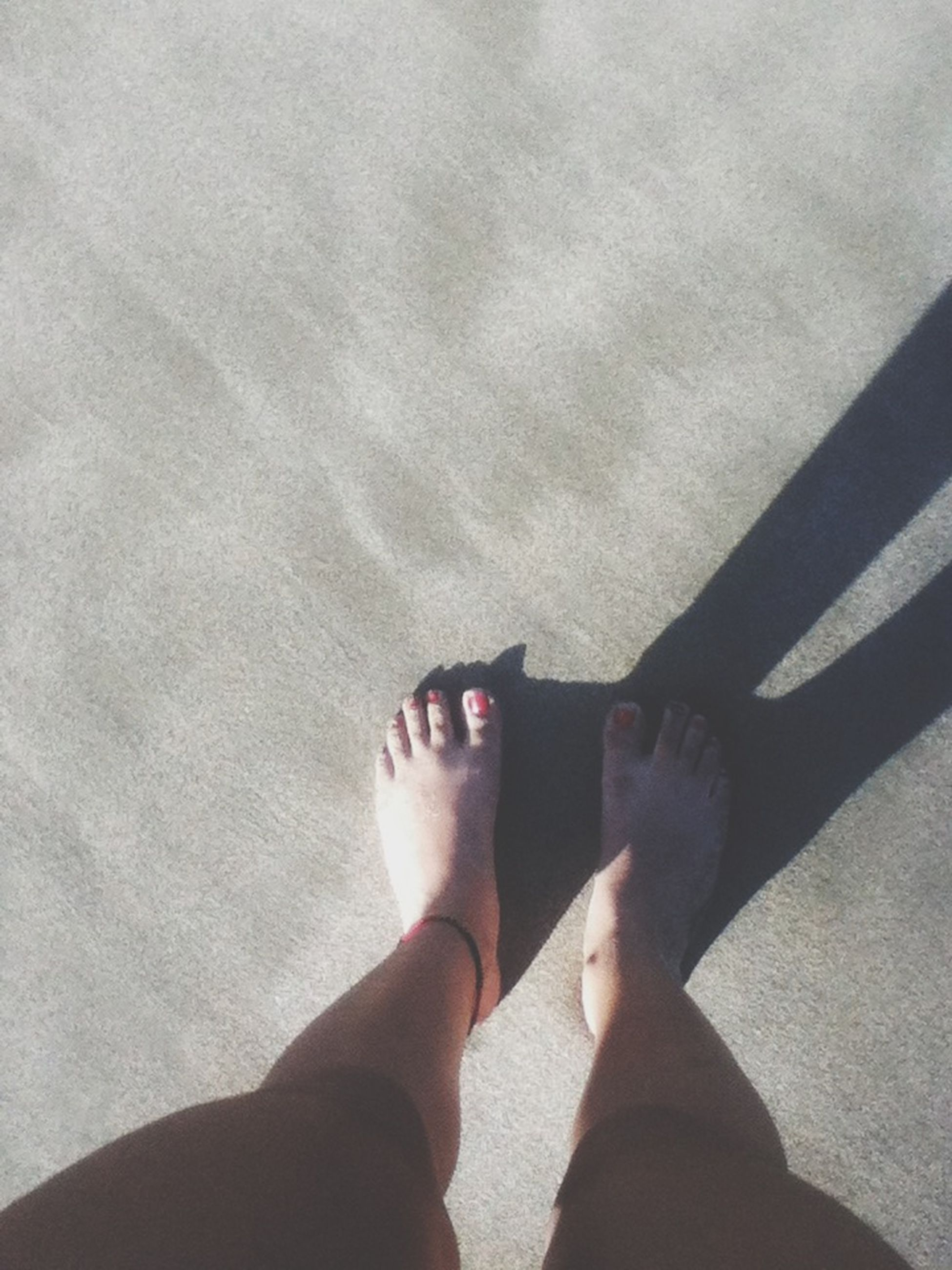 lifestyles, leisure activity, low section, person, men, part of, sunlight, standing, holding, human foot, personal perspective, barefoot, high angle view, shadow