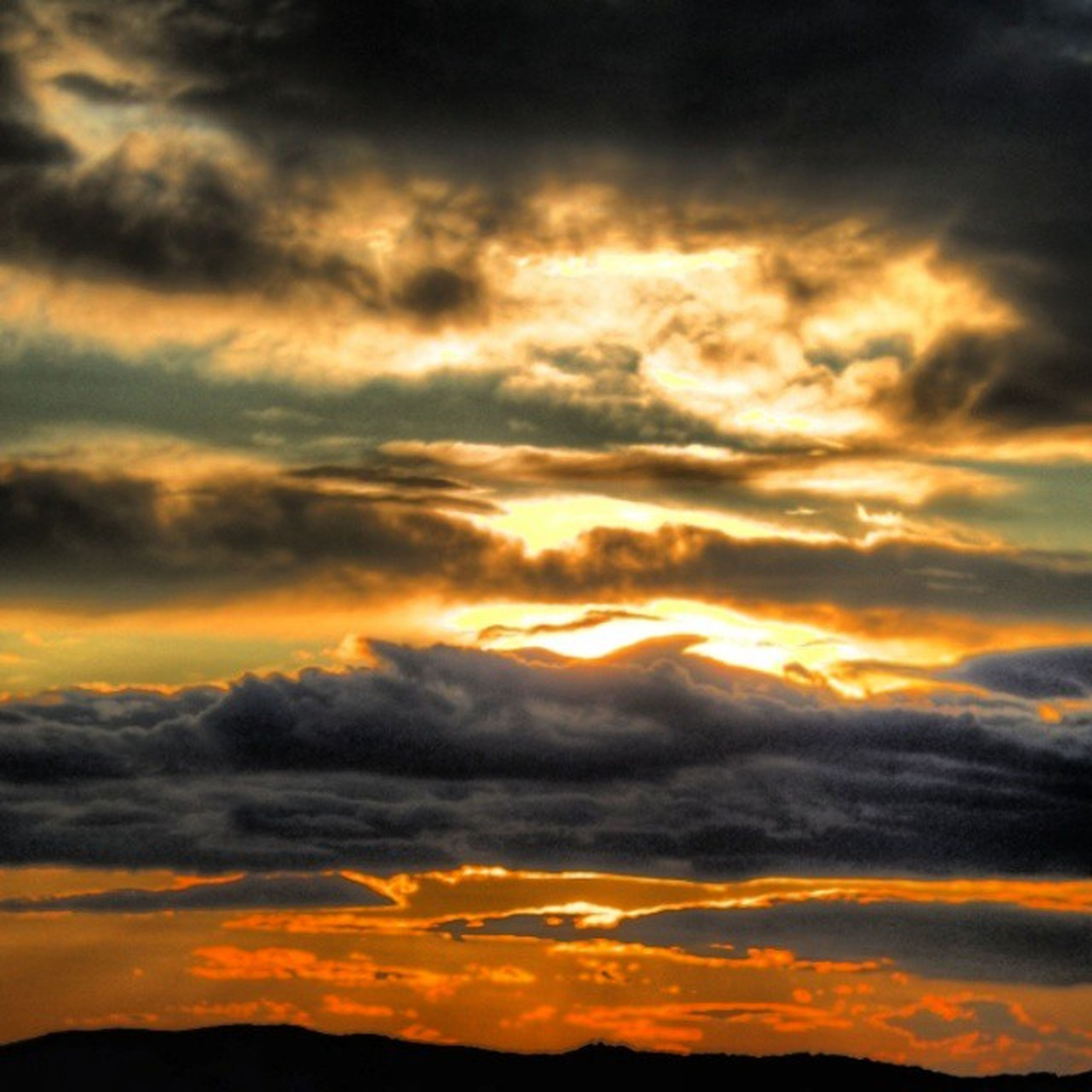 sunset, sky, scenics, orange color, beauty in nature, tranquil scene, tranquility, cloud - sky, dramatic sky, nature, idyllic, silhouette, cloudscape, cloudy, cloud, majestic, low angle view, weather, moody sky, atmospheric mood