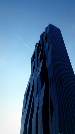 Blue Digital Composite Low Angle View No People Silhouette Sky Outdoors Day Contrast Full Frame Vienna High Contrast Austria Mobilephotography Sun Airplane Sky And City Building Highrise Skyscraper DC Tower Vienna Dctower