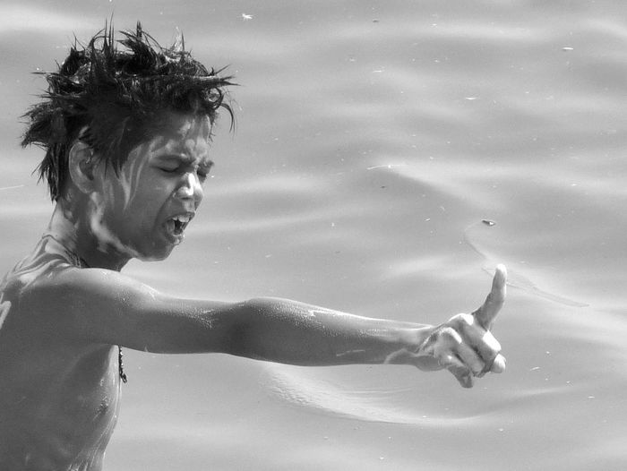 Washing on the Ganges river in Benares. This boy is very angry because his friends have taken his soap ! Ganges River Visual Creativity Angry Boy Boy Shouting Loud Expressive Face Indian Lifestyle.. One Person Outdoors Real Life River Bath Adventures In The City