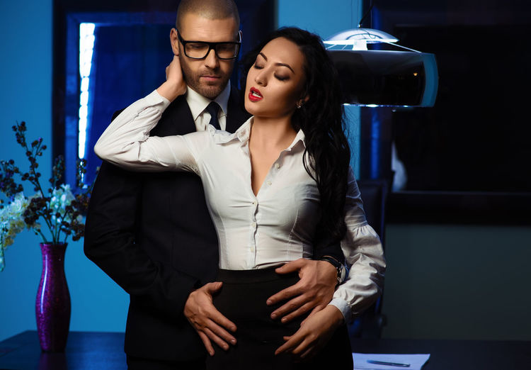 Businessman Romancing With Woman In Office