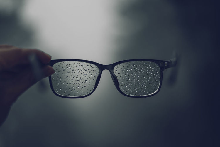 Forest road Fog and rain in the evening Human Hand Glasses Human Body Part Hand Holding One Person Close-up Real People Indoors  Unrecognizable Person Eyeglasses  Body Part Lifestyles Transparent Sunglasses Fashion Glass - Material Personal Perspective Water Finger Personal Accessory Eyewear