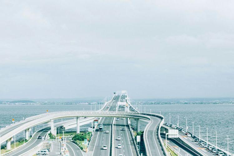 Tokyo bay aqua-line over sea against sky