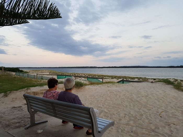 """If I were ever asked how I would ever like my future be.. my answer would be """"Just like this."""". Chill Life Relationship Goal Beach Bonding Day Love Love ♥ Nature Outdoors Pensioners Rear View Relaxation Sand Sea Senior Citizen  Senior Couple Sky Togetherness Water"""