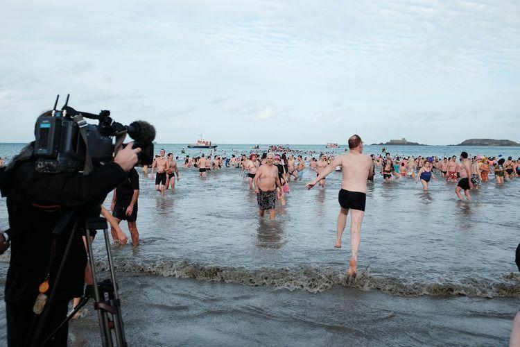 EyeEm Selects Water Beach Men Sea Adult Cloud - Sky Outdoors Day People Sky Swim Tv Camera Reporter Plage Dinard France Bretagne