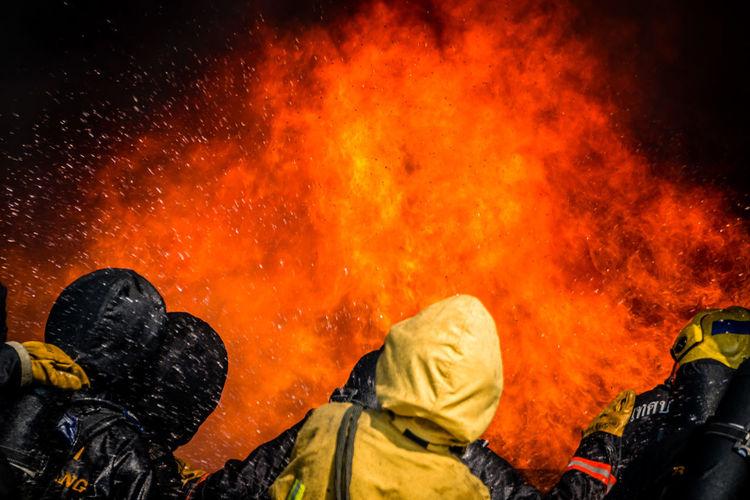 Firefighter against orange fire