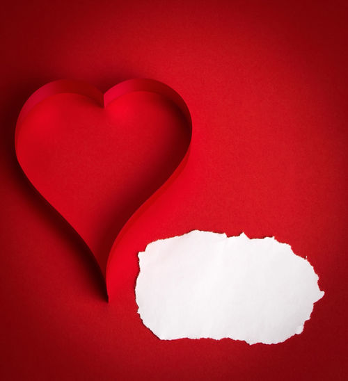 Directly above shot of heart shape against white background