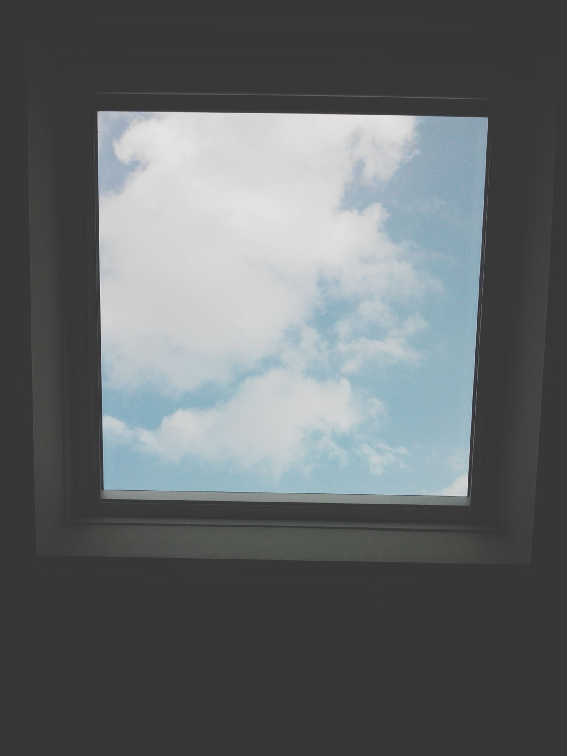 window, indoors, sky, architecture, built structure, glass - material, low angle view, transparent, cloud - sky, cloud, building exterior, day, glass, no people, building, looking through window, house, cloudy, geometric shape, silhouette