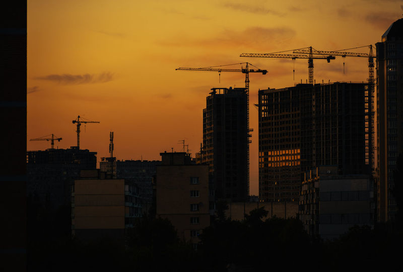 Silhouettes of building process of downtown district. Beautiful sunset in modern growing city Building Exterior Architecture Built Structure Building City No People Silhouette Nature Outdoors Sky Indusrty Kiev Ukraine Modern Financial District  Crane Crane - Construction Machinery Capital Cities