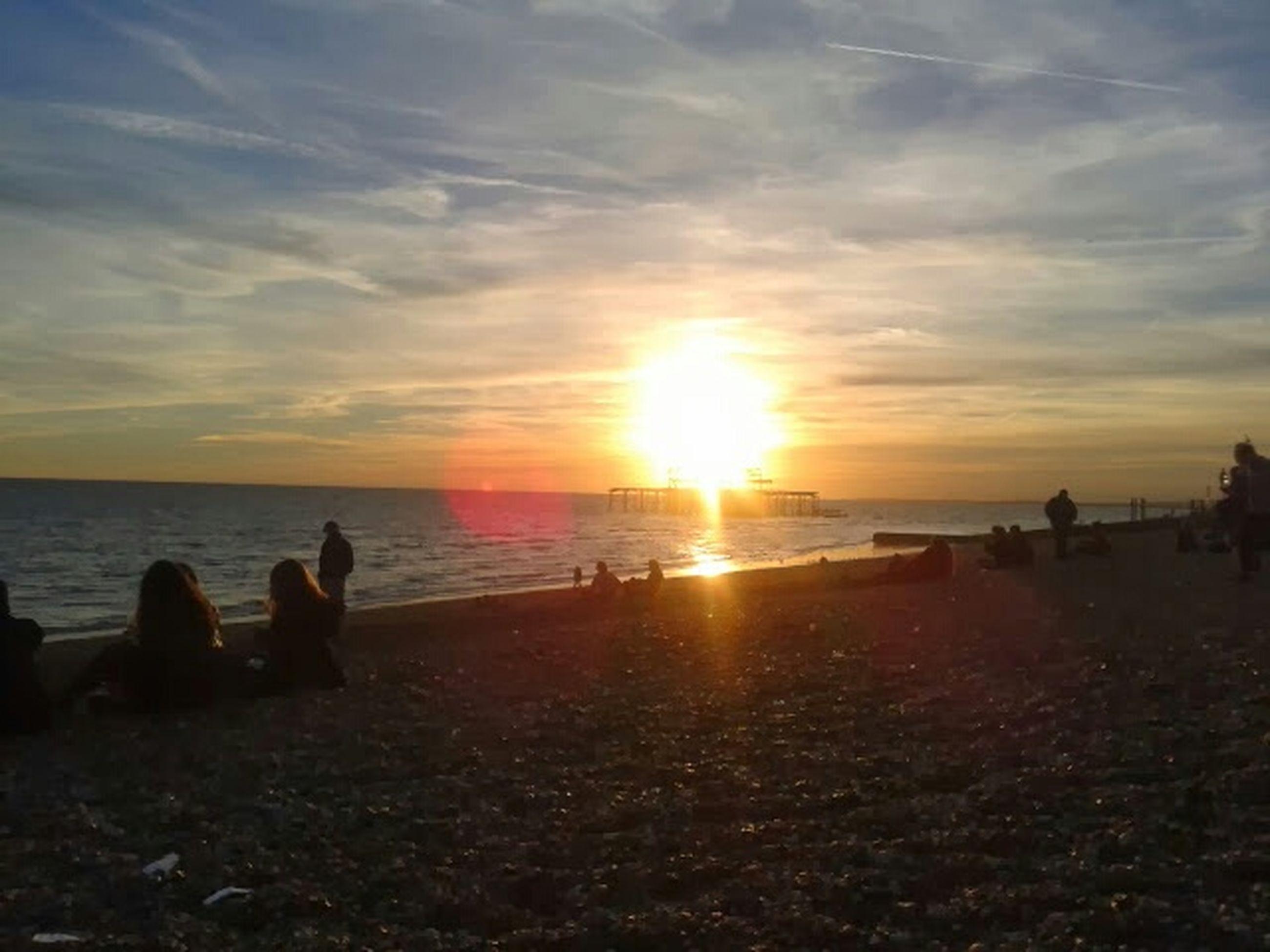 sea, water, sunset, horizon over water, beach, sky, scenics, sun, shore, beauty in nature, tranquil scene, tranquility, cloud - sky, silhouette, nature, idyllic, sunlight, incidental people, orange color