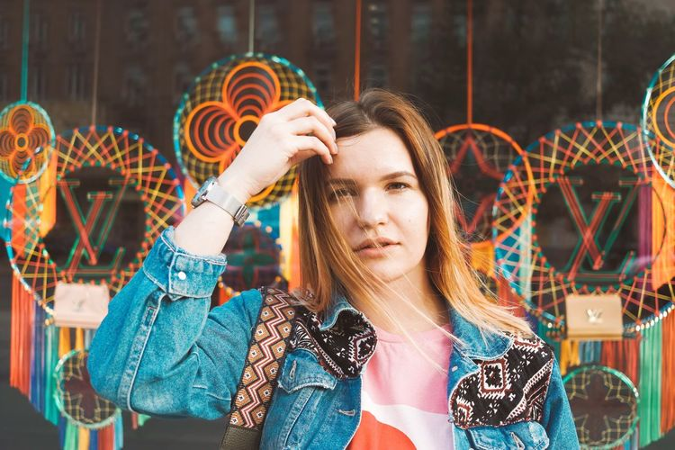 Portrait of young woman in amusement park