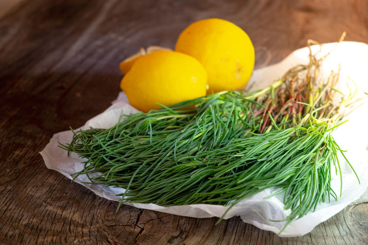 Agretti on wooden table with lemons Food And Drink Salad Agretti Close-up Egg Focus On Foreground Food Food And Drink Foodphotography Freshness Fruit Green Color Healthy Eating Herb High Angle View Indoors  Lemons No People Raw Food Rosemary Still Life Table Vegetable Vegetables Wellbeing Wood - Material