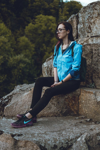 Cliff Jumping Cliffs Nike✔ Beautiful Woman Casual Clothing Day Full Length Happiness Leisure Activity Lifestyles Nature One Person Outdoors People Portrait Real People Rock - Object Sitting Smiling Tree Young Adult Young Women