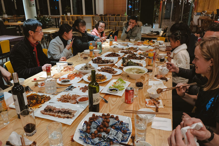 When we were arrived in China, it was the chinese new people who hosted us wanted to share with us their new year's was full of strange and delicious classic roasted duck to less known 12 years old egg. Dinner Time Modern Hospitality Share Your Adventure ShareTheMeal Adult Chinese Chinese Culture Chinese New Year Dining Dinner Dinner Table Dinnertime Eating Food Food And Drink Group Group Of People Hostel Leisure Activity Lifestyles Medium Group Of People Real People Sitting Table Togetherness