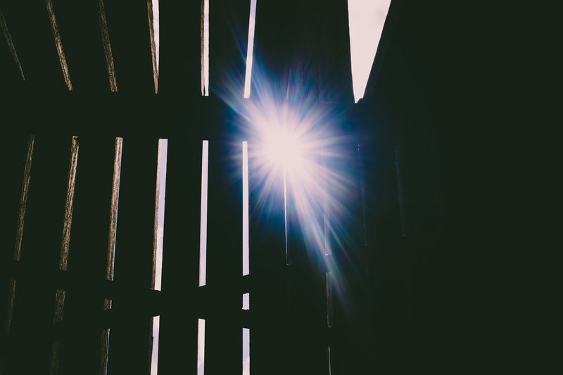 Low angle view of sunlight streaming through window