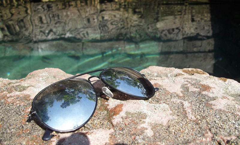 My Sunglasses Best Shots EyeEm Clean Water Beautiful Glasses Great Shot☆ My Glasses Water Reflections Clean Water Close-up Day Glass Nature No People Outdoors Pool Reflection Retaining Wall Rock - Object Sunglasses Temple Water Waterfront