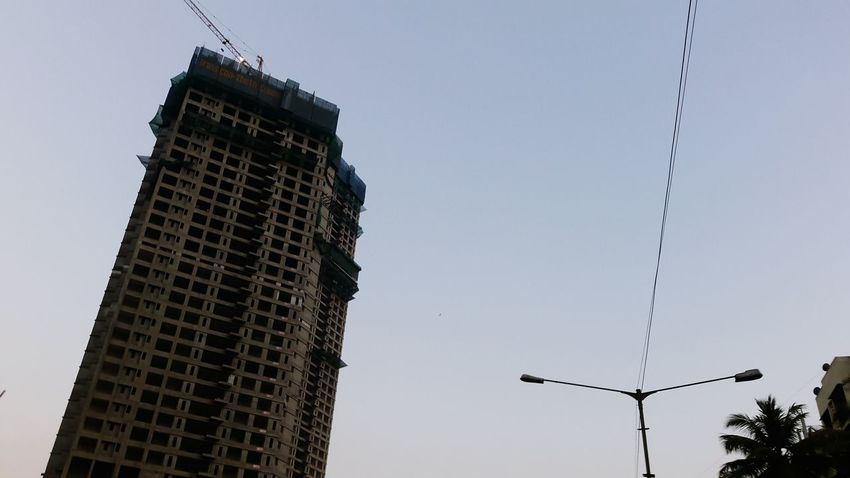 Construction Construction Site Construction Industry Business Finance And Industry Light Effect Sky City Sky Low Angle View Outdoors No People Skyscraper Illuminated Day Clear Sky Social Issues Wires Street Lights Environmental Conservation Fog