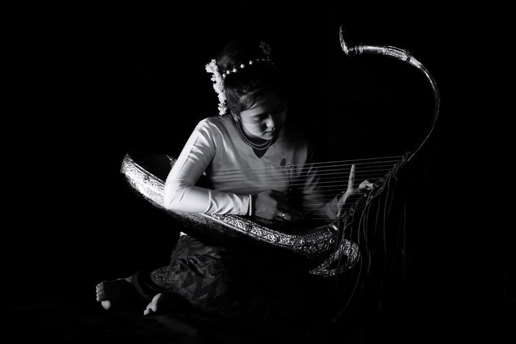 The Girl playing the Myanmar Harp Black Background Women Studio Shot Young Women Females Human Face Light Painting