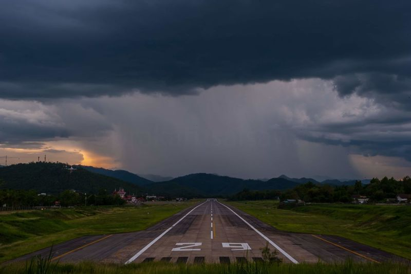 Panoramic view of storm clouds over road