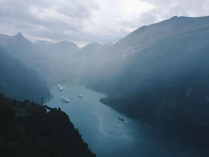 Geiranger fjord and village on a rainy day, nordic landscape