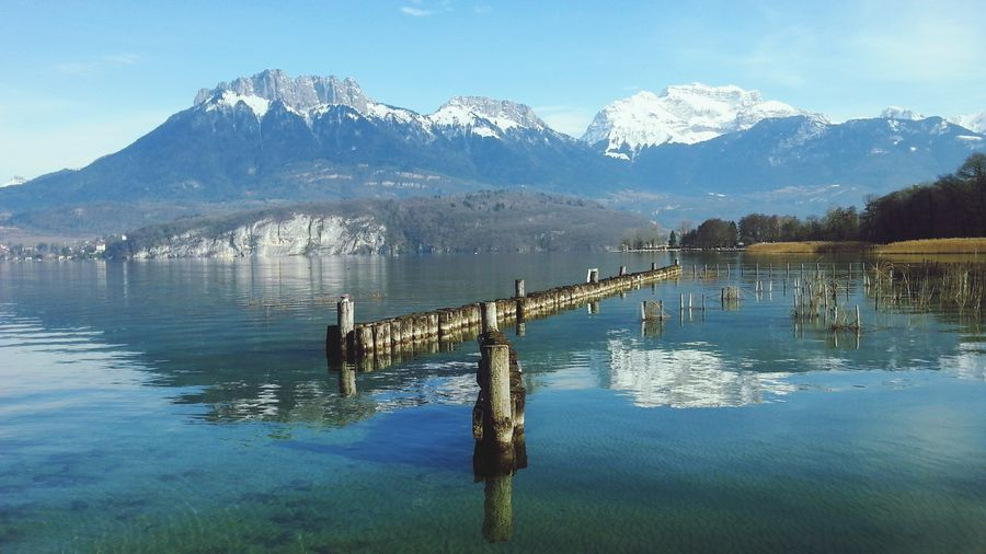 Landscape Beauty In Nature Outdoors Reflection Lake Annecy  Mountains And Sky Lake And Mountains Tranquility Nature Wooden Bridge Sky And Lake Beautiful Day Winter Day
