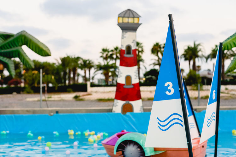 Close-up of sailboat in swimming pool against sky