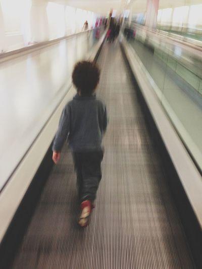 Blurred motion of people on escalator