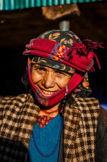 Close-up portrait of a smiling old woman