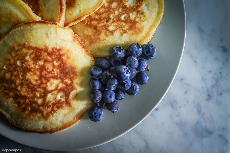 High Angle View Of Pancakes And Blueberries On Plate