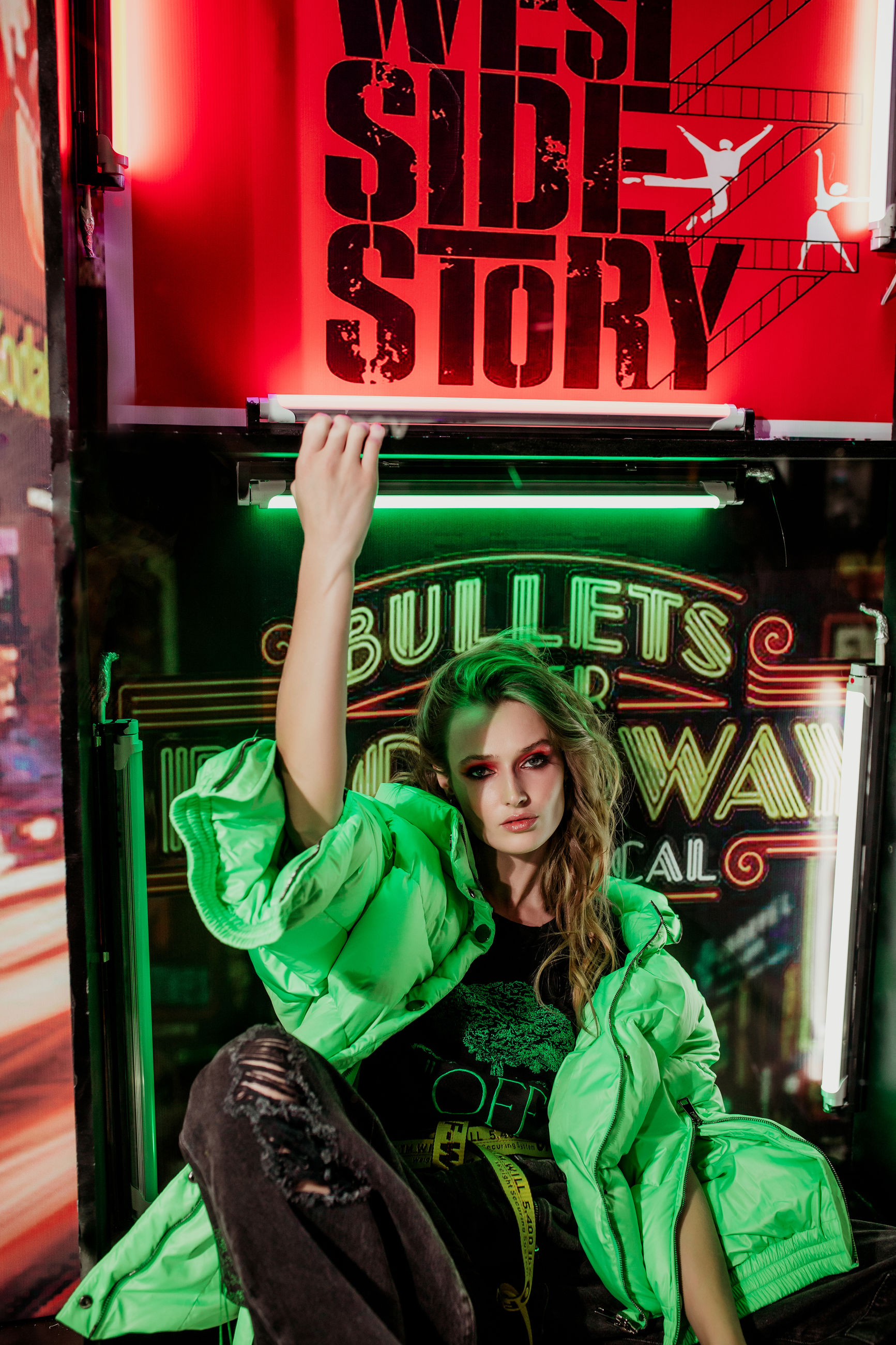 one person, leisure activity, text, front view, green color, real people, lifestyles, young adult, portrait, looking at camera, casual clothing, hair, women, sitting, illuminated, night, waist up, hairstyle, beautiful woman, teenager
