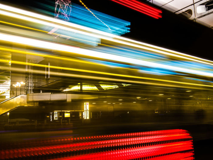 Light trails on train in city at night