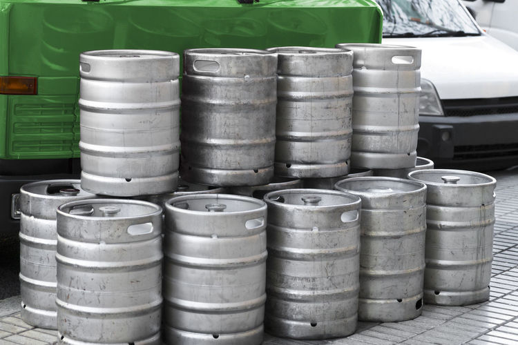 beer metallic kegs in city street for delivery Beer Beer Barrels Beer Keg Beer Kegs Industrial Service Alcohol Alcohol Drinks Barrel Beer Stack Container Drink Factory Food And Drink Industry Large Group Of Objects Metallic Kegs No People Refreshment Stack