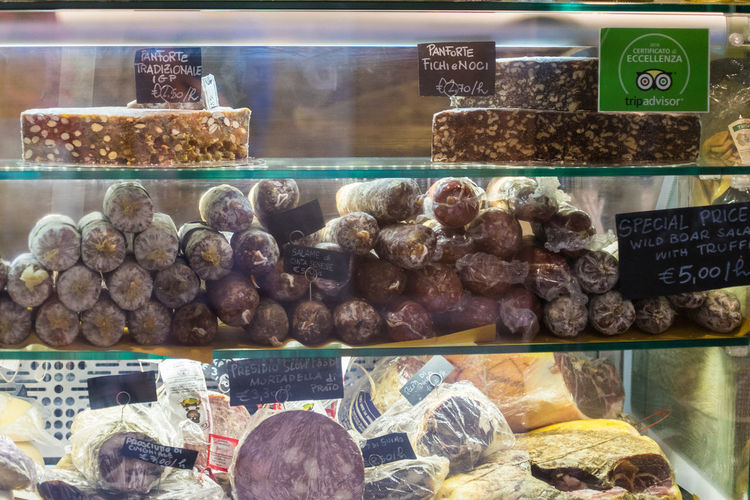 Some food from italy Abundance Business Choice Display Cabinet Food Food And Drink For Sale Freshness Glass - Material Large Group Of Objects Market Meat No People Order Price Tag Retail  Retail Display Salami Sale Shopping Store Text Transparent Variation
