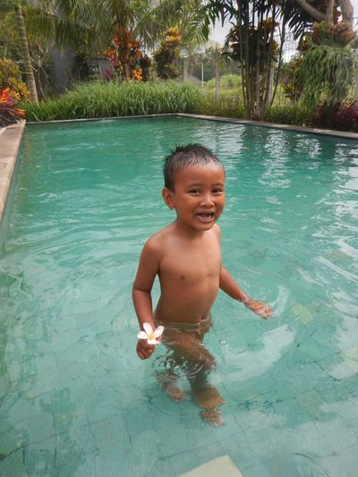 smile Water Leisure Activity Smiling Swimming Lifestyles Weekend Activities Front View Swimming Pool Vacations Enjoyment Childhood Chrisphotography Indonesia_photography People And Pleaces First Eyeem Photo People And Places Family With One Child Boy