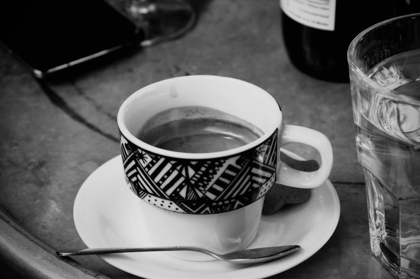 "Had this Cup of Espresso at Club-cafe Niebostan. The name literally translates into ""state of heaven"" or ""state of sky"" - blissfulness would be more exact word though. The place is located in one of the backyards of Piotrkowska street and has a really cool outside staircase - that's where we sat. Black And White Spoon Glass Water Phone via Fotofall"