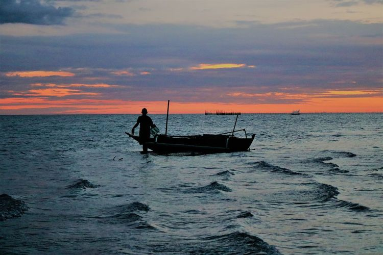 Most of the world is covered by water. A fisherman's job is simple: Pick out the best parts.      Charles Waterman Boat Men Work Bay Sea Cean Wallpaper Sunset Water Nautical Vessel Sea Sunset Full Length Beach Fisherman Silhouette Standing Fishing Seascape Wave