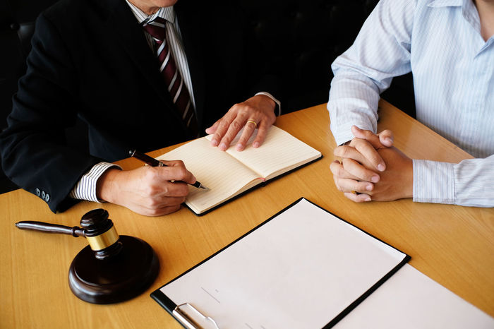 Legal counsel presents to the client a signed contract with gavel and legal law. justice and lawyer concept Authority Business Justice - Concept Lawyer Rights Advisor Agreement Barrister Business Finance And Industry Communication Consultant Contract Corporate Courthouse Courtroom Defendant Document Expertise Indoors  Judgment Lawn Legal Men Process Success