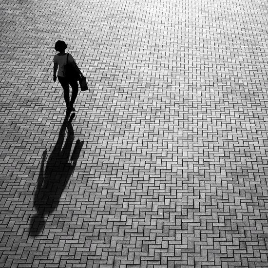 Shadow waiting game Early Morning Sunlight Blackandwhite Streetphotography Woman Woman Walking Perspective City Streets  From My Point Of View IPhoneography Hong Kong Solitude Street Look Down No Traffic Pedestrian Walking Street Life My Hong Kong Showcase: November IPS2015Light B&w Street Photography IPS2016Street A Bird's Eye View