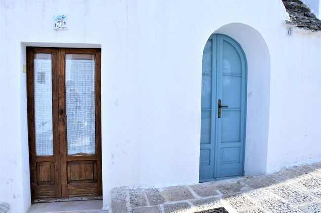 Architecture Building Exterior Built Structure Closed Day Door Entrance Finding New Frontiers Front Door House No People Outdoors Puglia Travel Travel Destinations Travel Photography Traveling Unesco UNESCO World Heritage Site Whitewashed Traveling Home For The Holidays