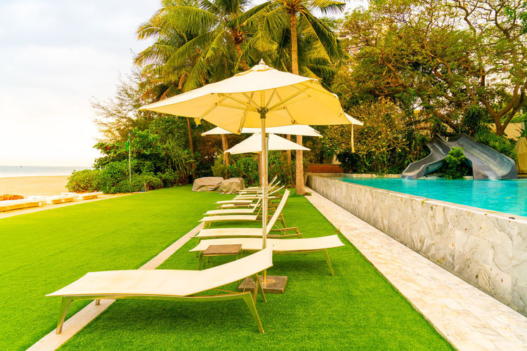Deck chairs by swimming pool