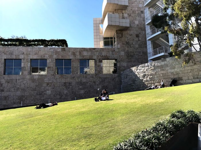 Modern building and restful environment ADMIRING Dreaming Couple Grass Green Getting Rest People Stone Material Architecture Built Structure Building Exterior Sunlight Shadow Day Outdoors Real People Sky City