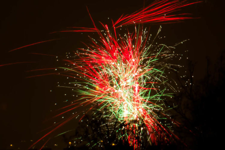 Night Illuminated Nature No People Celebration Firework Motion Arts Culture And Entertainment Glowing Event Long Exposure Firework Display Exploding Low Angle View Multi Colored Blurred Motion Light Firework - Man Made Object Outdoors Sky