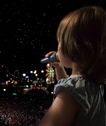 Digital Composite Image Of Girl Singing At Night