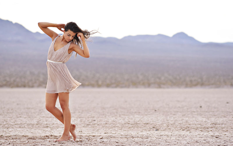 Young Adult Full Length Real People Lifestyles Women Standing Adult Beauty In Nature Casual Clothing Nature Tranquility Beauty Day Tranquil Scene Focus On Foreground Beautiful Woman Freedom Hairstyle Fashion Outdoors Human Arm Fashion Photography Desert Beauty Modeling Shoot Fashion Model