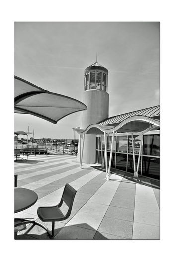 Observation Deck At Jack London Square 2 Embarcadero Cove Port Of Oakland, Ca. Art Is Everywhere Architecture Nautical Theme Architectural Feature Wave-rendered Awning Lookout Lighthouse Tower Ocean-tinted Glass Jack London Square Marina Nautical Fuel Depot Restaurant, Retail & Entertainment District Waterfront Opposite Shore Alameda Marina Monochrome_Photography Monochrome Black & White Black & White Photography Black And White Collection  Black And White Deck Seating Shadows