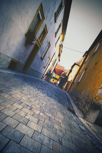 Small alley Alley Architecture Building Building Exterior Built Structure City Cobblestone Day Diminishing Perspective Direction Footpath Long Low Angle View Mode Of Transportation Narrow No People Outdoors Paving Stone Residential District Sky Stone Street The Way Forward Transportation