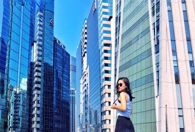 Women Around The World City Skyscraper One Person Communication Young Adult Adults Only Only Women Blue One Woman Only Outdoors Built Structure Building Exterior One Young Woman Only People Connection Business Confidence  Adult Day Architecture HongKong