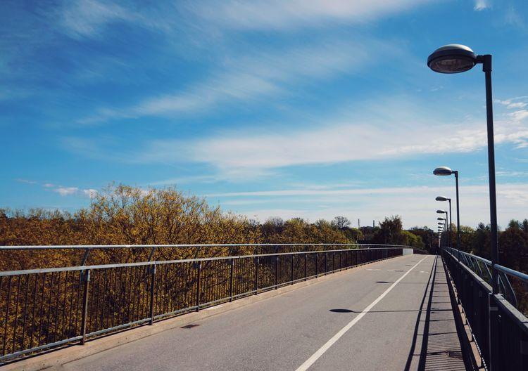 Street by road against sky